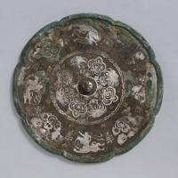 金銀平脱童子騎獣紋八花鏡-1